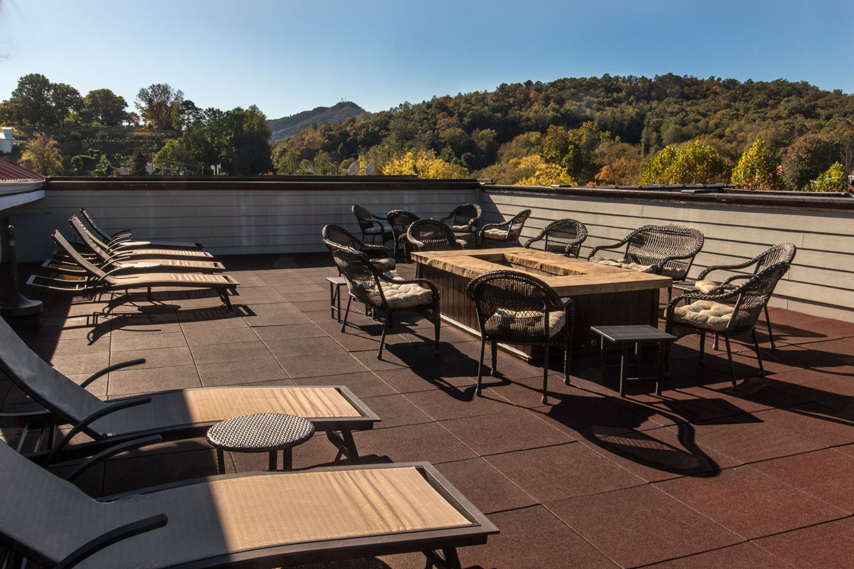 rooftop terrace with seating, firepit and mountain view